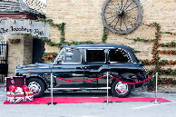 Penny our classic black London taxi cab photo booth for hire
