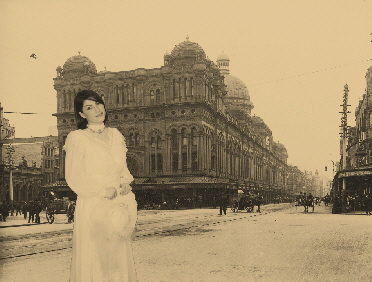 An image of a bride, taken and transposed onto a  Victorian street scene, then aged to simulate an original photograph.